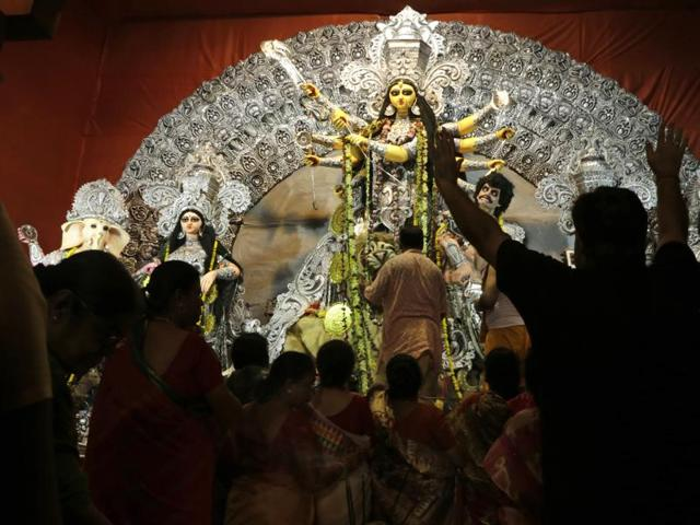 Devotees throng around a worship place for goddess Durga during Durga Puja festival in Kolkata.