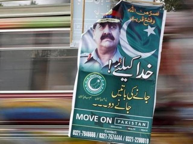 A banner with a photograph of Pakistan's Army Chief of Staff General Raheel Sharif along a road in Karachi, Pakistan February 25, 2016. REUTERS/Akhtar Soomro/Files