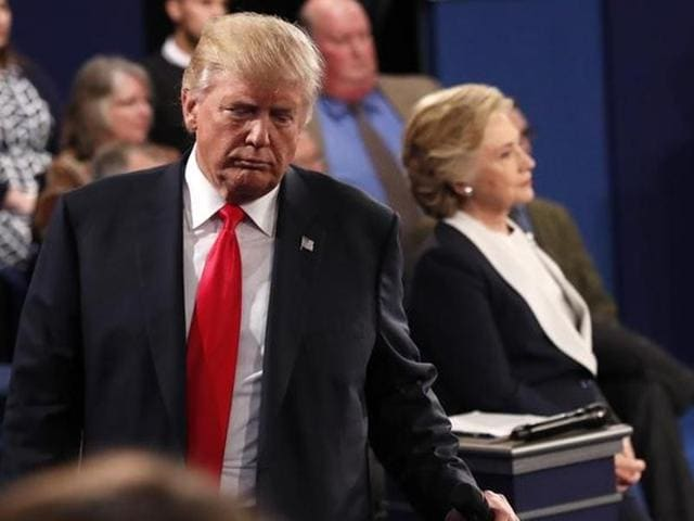 Republican US presidential nominee Donald Trump and Democratic US presidential nominee Hillary Clinton pause during their presidential town hall debate at Washington University in St Louis.