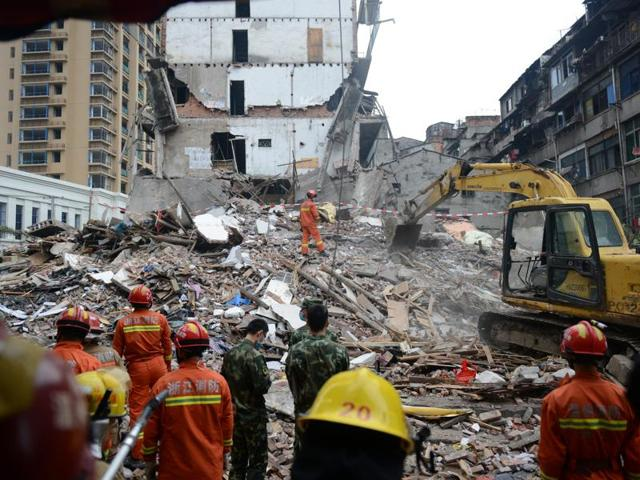 Rescue workers search at the site where residential buildings collapsed in Wenzhou, Zhejiang province, China.