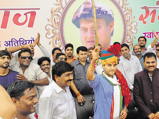 Congress MP Jyotiraditya Scindia waves a sword to his supporters at a programme of the Baghel-Pal community in Gwalior on Sunday.