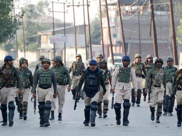 Security personnel during a patrol a street in Srinagar following protests over the death of a 11-year-old boy due to pellet injuries.