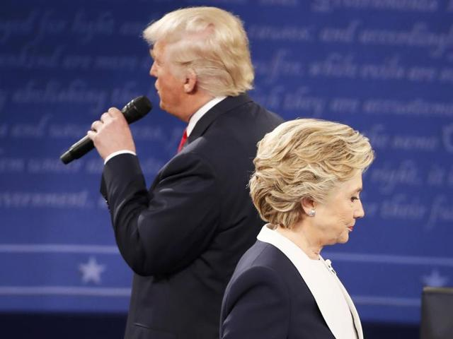 Republican US presidential nominee Donald Trump and Democratic US presidential nominee Hillary Clinton react as an audience member asks the candidates to say what they admire about each other during their presidential town hall debate at Washington University in St. Louis.