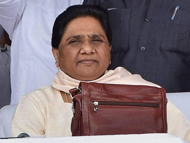 BSP chief Mayawati with party workers at a function to commemorate the tenth death anniversary of the party founder Kanshiram in Lucknow.