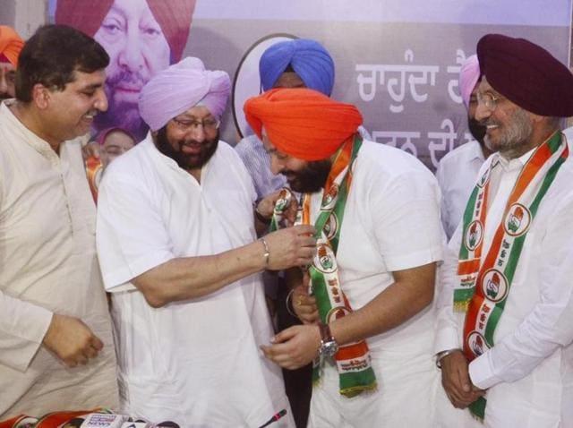 Punjab Congress chief Captain Amarinder Singh inducting Inderbir Singh Bolaria in Amritsar on Tuesday.
