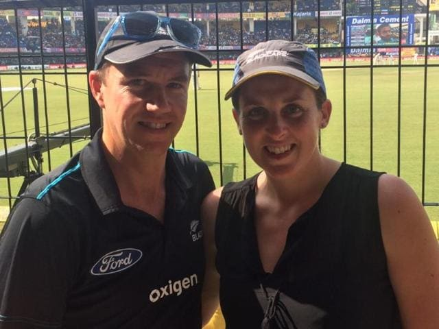 The couple sat in the stands wearing Black Caps jerseys on Monday.