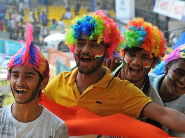 A cricket fan dressed up as Ravana enjoys the third day of India-New Zealand test match at Holkar stadium in Indore on Monday.