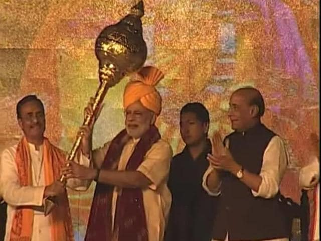 BJP's PM candidate for the 2014 elections and Gujarat chief minister Narendra Modi with retired Army chief VK Singh during Modi's rally in Rewari, Haryana. (PTI Photo)