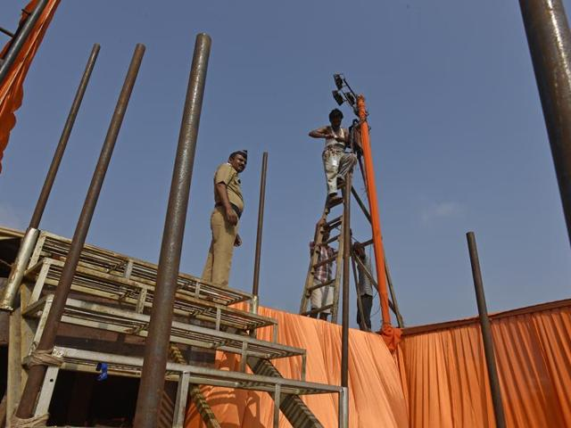 A worker sets up the stage at Mumbai's Shivaji Park for the Shiv Sena's annual Dussehra rally.