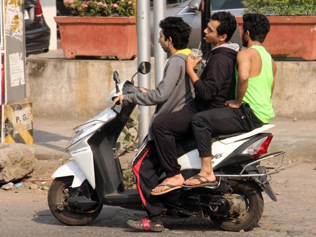 Taking your bike out for a spin? Riding pillion? Don't forget your helmet behind