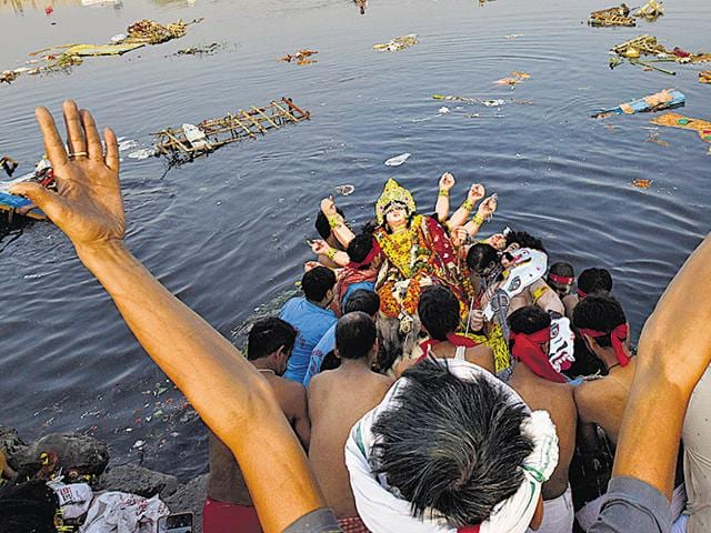 Hundreds of Durga idols were immersed at around seven Yamuna ghats across the national capital on Tuesday, with authorities trying to ensure that non-biodegradable items do not make it to the already polluted river.