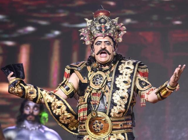 Actor Gajendra Chauhan play Ravana during Dussehra celebrations Lovkush Ramlila at Red Fort in New Delhi, on Tuesday.