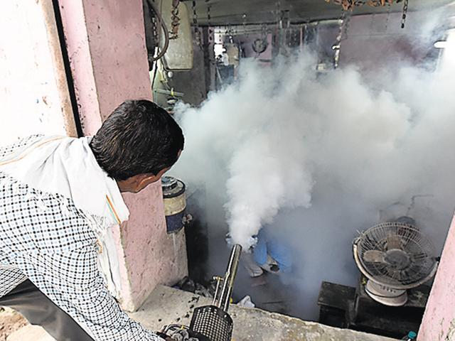 Corporation workers fumigate houses in east Delhi.
