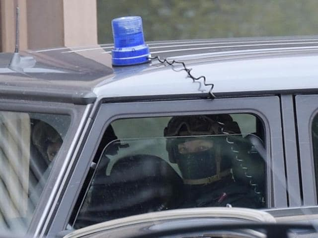 Special police forces secure the perimeter of the district court in Dresden after 22-year-old Jaber Albakr was arrested in the eastern city of Leipzig in connection with a bomb plot.