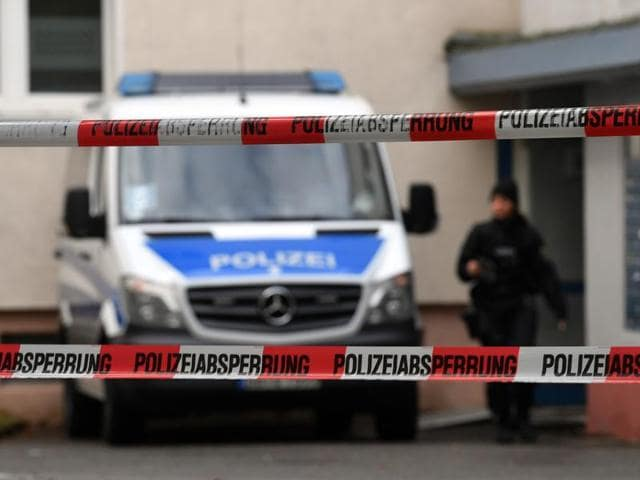 Police officers secure a cordoned off residential property in a housing estate in Chemnitz, eastern Germany, where police were investigating a possible bomb plot.