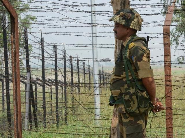 A soldier takes position near the Line of Control in Nowshera sector on Monday.