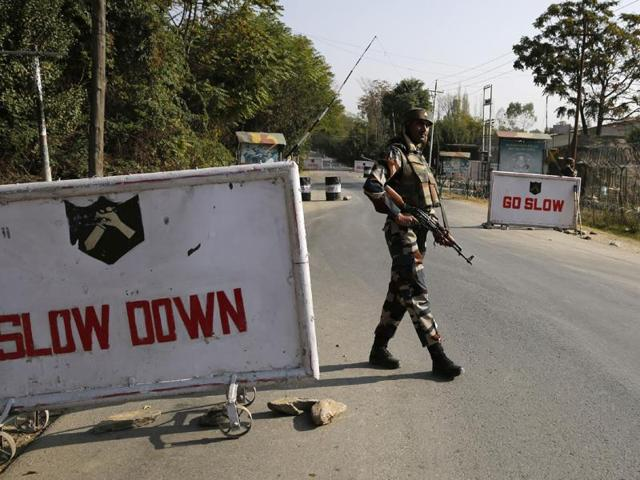 A soldier stand guard at the entrance to an army camp in Baramulla.