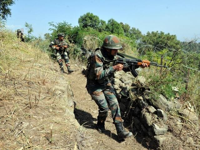 Soldiers patrol near the Line of Control  in Pallanwal sector, about 75 kilometers from Jammu, October 4