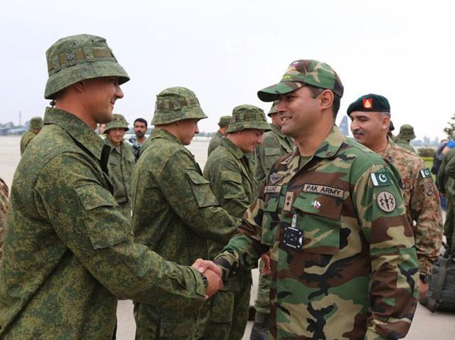 In this handout photograph released by Pakistan's Inter Services Public Relations (ISPR) on September 23, 2016, Pakistani military officials meet with Russian troops upon their arrival at a Pakistan military base at an undisclosed location.