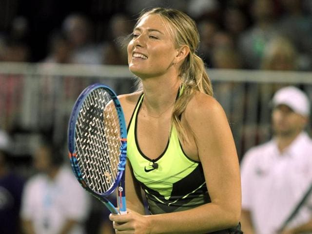 Maria Sharapova reacts after a point during a World Team Tennis exhibition.