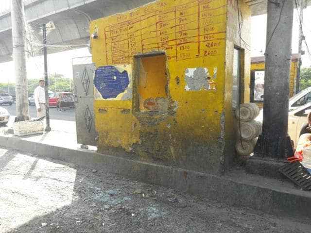 A toll booth that was damaged by goons on MG Road, Gurgaon on Wednesday.