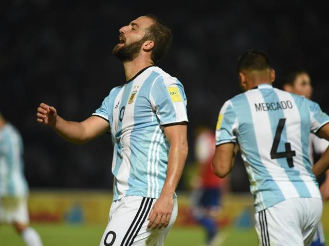 Argentina's players leave the field dejected after their loss to Paraguay.