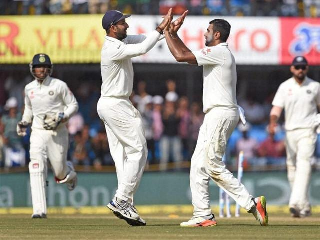Indian bowler R Ashiwin with Cheteswar Pujara celebrates the wicket of New Zealand batsman Ross Taylor during the 4th day of the third test match in Indore on Tuesday.