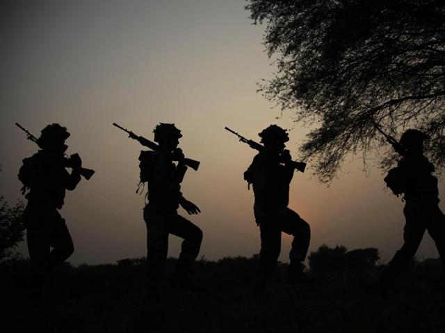 Indian army soldiers patrol near the Line of Control in Nowshera sector, about 90 kilometers from Jammu.
