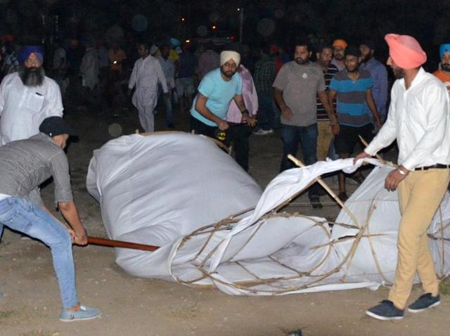 Youth Akali Dal workers damaging an effigy of Ravana, prepared by the Congress, in Ludhiana on Monday night.
