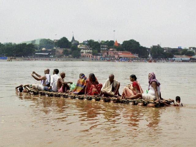 Photo shows Hindu devotees cross Falgu river to perform Pind Daan rituals during Pitra Paksha in Bodhgaya, Gaya.