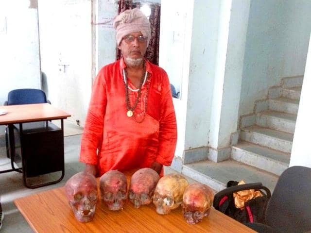 Five human skulls, Rs 18,000 cash and fake cash memos were recovered from Gond's house.