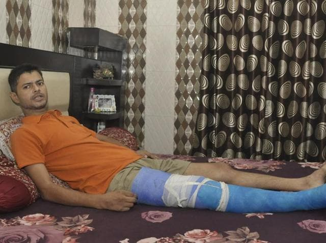 Injured Ashish Sohal at his residence in Jalandhar on Wednesday.
