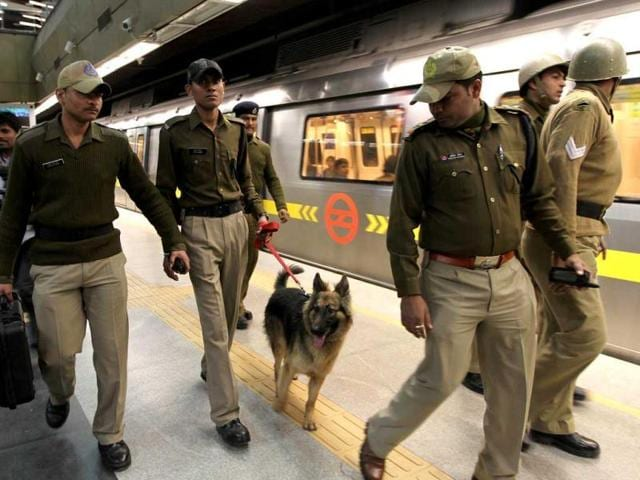 Security officials stand by during a mock drill at AIIMS metro station in New Delhi.