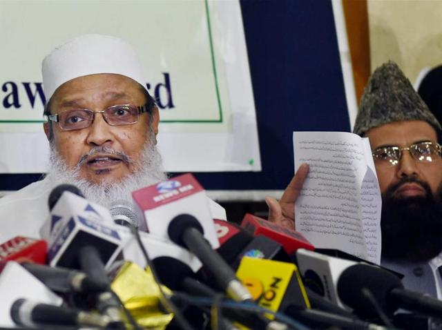 Syed Mohammad Wali Rahmani, General Secretary of the All India Muslim Personal Law Board (AIMPLB) with Jamiat Ulema-e-Hind President Maulana Syed Arshad Madani (L) and others during a press conference in New Delhi.