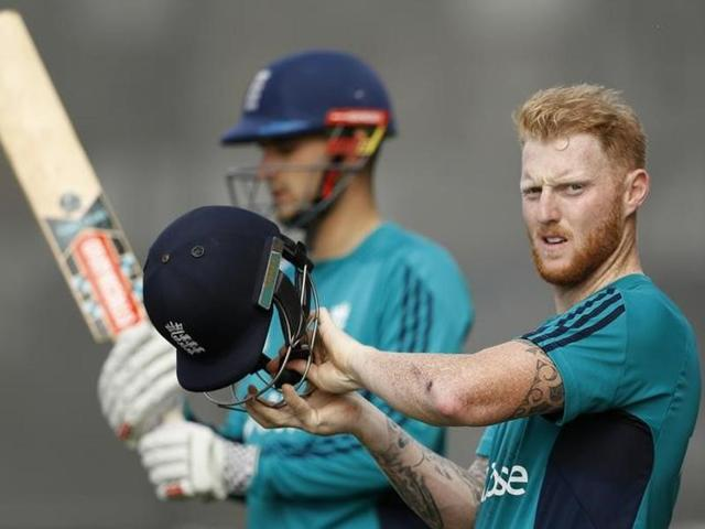 England's Ben Stokes, right, and Chris Woakes, centre, celebrate their victory against Bangladesh.