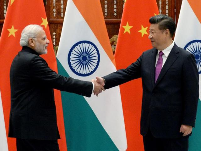 Prime Minister Narendra Modi (left) shakes hands with Chinese President Xi Jinping at the West Lake State Guest House ahead of the G20 Summit in Hangzhou, Zhejiang province, China.