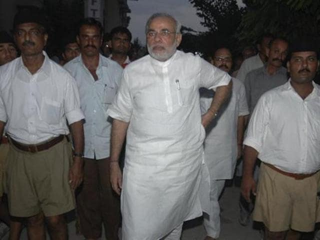 PM Narendra Modi with RSS swayamsewaks. RSS chief Mohan Bhagwat's Dussehra speech denoted a shift in equation between the Sangh and the BJP.