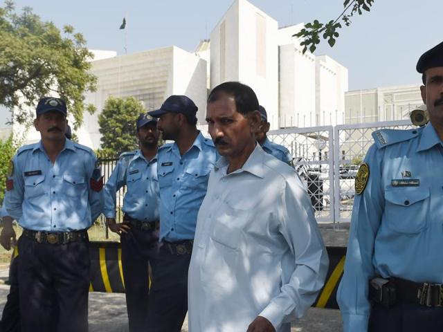 Ashiq Masih (in white), husband of Christian woman Asia Bibi who faces the death sentence for blasphemy, leaves the Supreme Court in Islamabad on Thursday.