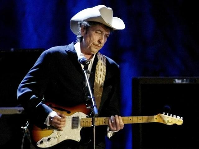 This file photo taken on July 22, 2012 shows US poet and folk singer Bob Dylan performing during the 21st edition of the Vieilles Charrues music festivalin Carhaix-Plouguer, western France.