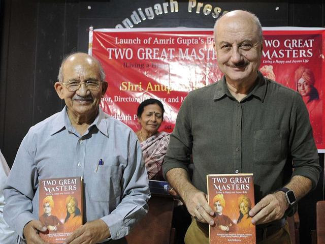 Author Amrit Gupta and actor Anupam Kher launching book 'Two Great Masters' at the Press Club on Thursday.