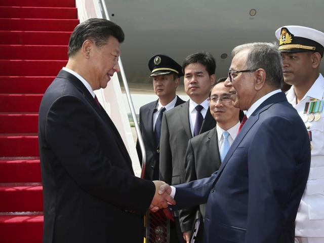 China's President Xi Jinping shakes hands with Bangladesh's President Abdul Hamid in Dhaka.