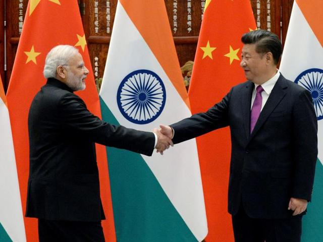 Prime Minister Narendra Modi shakes hands with Chinese President Xi Jinping at the West Lake State Guest House ahead of G20 Summit in Hangzhou, Zhejiang province, China.