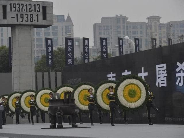 File photo of paramilitary policemen with wreaths marching during a ceremony to mark the second national memorial day for the Nanjing Massacre in Jiangsu province, China, in December 2015.