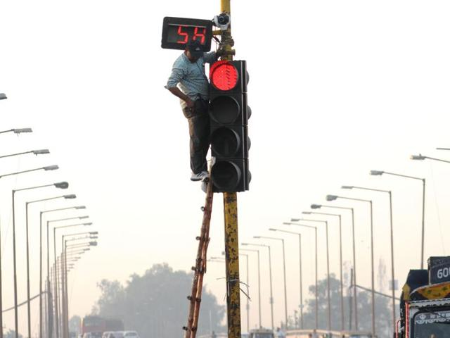 A CCTV camera being put up at the bus stand chowk in Patiala on Thursday.