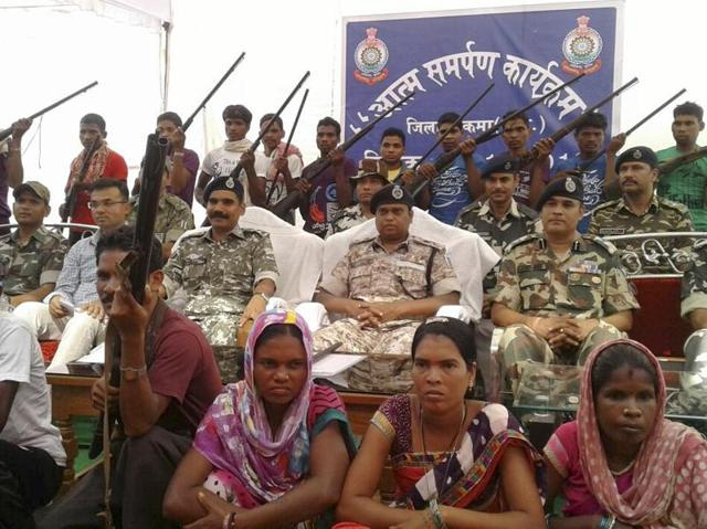 Maoists surrender during a mass surrender camp in Sukma.