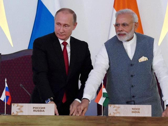 Prime Minister Narendra Modi with Russian President Vladimir Putin, laying the foundation concrete of the Kudankulam Nuclear Power Plant units 3 & 4 at the agreement exchange ceremony after the 17th India-Russia annual summit meet in Benaulim, Goa on Saturday.