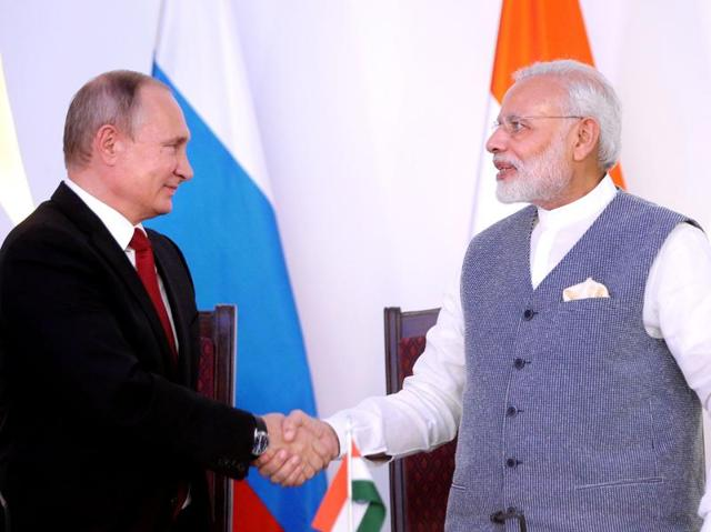 Prime Minister Narendra Modi shakes hands with Russian President Vladimir Putin during the exchange of agreements and joint press statements ceremony at Taj Exotica hotel in Goa on Friday.