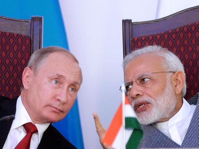 Prime Minister Narendra Modi (R) shakes hands with Russian President Vladimir Putin during the exchange of agreements and joint press statements ceremony at Taj Exotica hotel in Goa on Friday.
