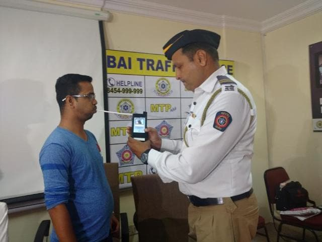 A constable demonstrates how to use the new breathalyser at the traffic police headquarter in Worli, on Saturday.