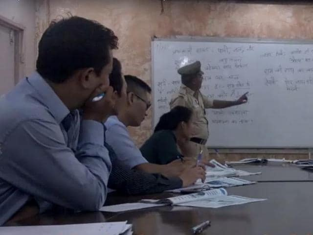 A group of 12 Delhi Police subinspectors meet at the police library to take Hindi lessons.